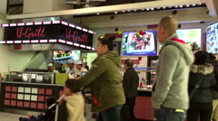People line up for buying food at food court area inside Burnaby shopping mall Stock Footage
