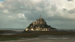 sunshining between storm clouds on mont st michel, france - stock footage