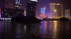 Hotel Buildings, Neon Lights and Water Reflections in Night Macau City Stock Footage