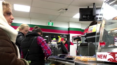 One side of check out counter inside 7-eleven convenience store - stock footage