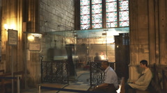 Waiting for confession in notre dame cathedral, paris Stock Footage