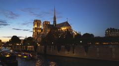 Notre dame cathedral and a river tour boat, paris Stock Footage