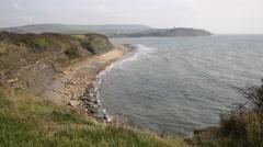 Kimmeridge Bay Dorset coast England uk towards Clavell Tower Stock Footage