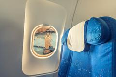 Airplane window with view on Tower Bridge. London tourism concept Stock Photos