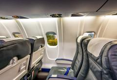 Airplane interior with view on New York City. Tourism and travel concept Stock Photos