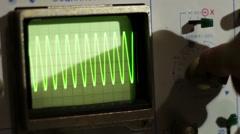 Adjusting Signal Oscilloscope Stock Footage