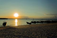 Nusa penida, Bali beach with dramatic sky and sunset - stock photo