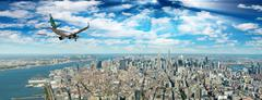 Airplane landing in New York City. Travel and tourism concept Stock Photos