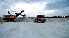 Heavy mining dump trucks driving along the opencast - stock footage