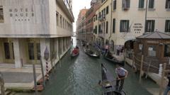 Rowing gondolas on Rio de S Moise in Venice Stock Footage