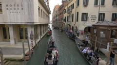 Paddling gondolas on Rio de S Moise in Venice Stock Footage