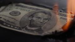 Five dollars burning close-up Stock Footage