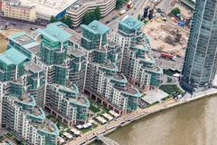 Aerial view of London along river Thames - stock photo