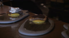 Dolly shot of a chef assembling three desserts - stock footage