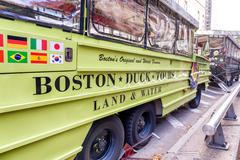 BOSTON - SEPTEMBER 12, 2015: Tourists along city streets. Boston attracts one Stock Photos