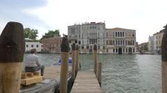 Palazzo Da Mula Morosini seen from a wooden pier in Venice Stock Footage