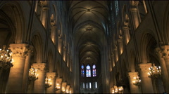 Slow zoom out of the nave in notre dame cathedral, paris Stock Footage
