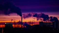 Modern city in the evening at sunset. Smoke comes out of the pipes. Stock Footage