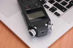 Audio recorder and laptop Kuvituskuvat
