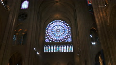 Medium view of the stained glass window in notre dame cathedral, paris Stock Footage