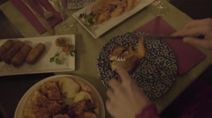 Young Adult Woman eating tapas in restaurant Stock Footage