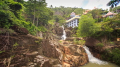 Waterfalls Cascade on Mountain River Green Slopes Houses Stock Footage