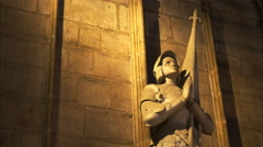 Marble statue of a knight in notre dame cathedral, paris Stock Footage