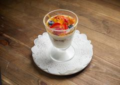 Sweet dessert in glass with biscuit,berry fruit and whipped cream Stock Photos