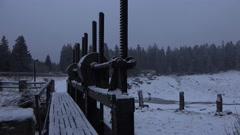 4k Sluice gate winter forest Harz mountains Oderteich lake Stock Footage