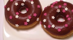 Delicious donuts with icing on plate Stock Footage