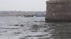 River tug of bridge piers of granite blocks, bridge over the river, 4k Stock Footage