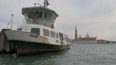 Guardi boat anchored close to Piazza San Marco in Venice Stock Footage