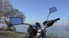 Leather blue motorcycle mirrors on the background of the river Stock Footage