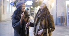 Two women chatting in a street in winter Stock Footage