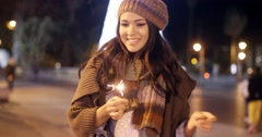 Pretty young woman celebrating with a sparkler Stock Footage