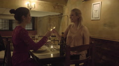 Young Adult Females toasting in restaurant Stock Footage