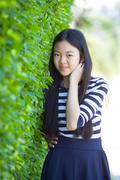 portrait of younger asian teen with happiness emotion and smiling face in gre - stock photo