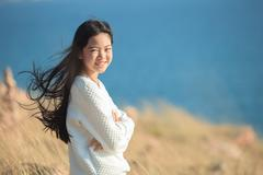 portrait of young asian girl  smiling face happiness emotion with blue blur b - stock photo