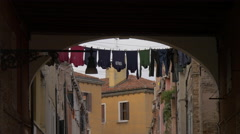 Colorful clothes drying on a clothes line in Venice Stock Footage