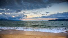 Foamy Sea Surf on Sand Beach Cloudy Sky at Sunset Stock Footage
