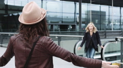 Reunited and hugging friends on airport arrival Stock Footage