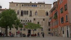 Adults and children relaxing on Calle Crosera in Venice - stock footage