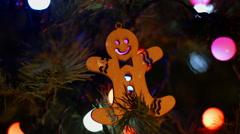 Christmas Christmas toy hanging on the Christmas tree lit garland Stock Footage