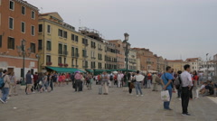 Tourists walking and standing on Riva degli Schiavoni in Venice Stock Footage