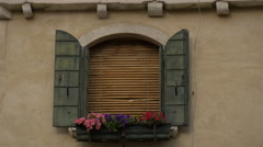 Old window with window shutters and flowers in Venice - stock footage