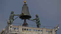 Two statues ringing the bell on top of Torre dell'Orologio in Venice Stock Footage