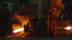 Heavy Industry Worker Working Hard on Machine in Foundry. Industrial Environment - stock footage