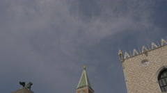 Tilt down view of Colonne di San Marco e San Todaro and St Mark's Tower, Venice Stock Footage