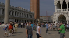 Tilt up view of Colonne di San Marco e San Todaro and St Mark's Tower in Venice Stock Footage