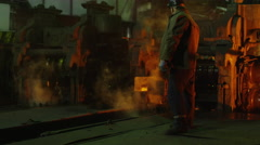 Heavy Industry Worker Working Hard in Foundry. Industrial Environment. Wide Shot - stock footage